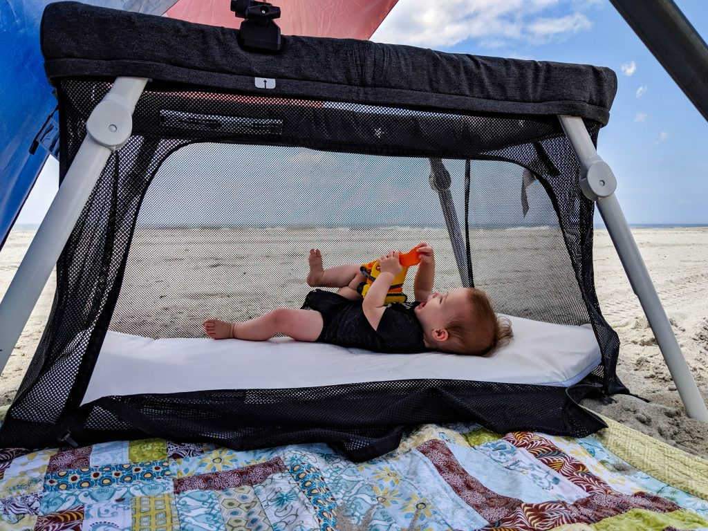 Pack and play at the beach with baby