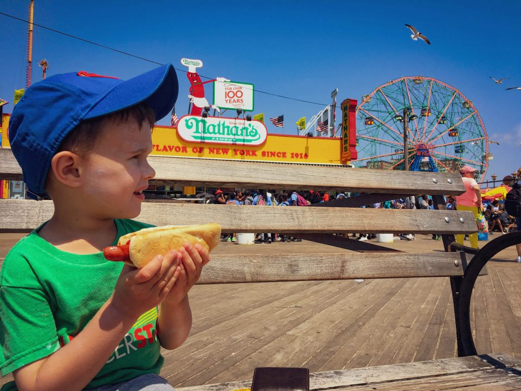 Nathan's Famous Hot Dog - A great toddler friendly restaurant in NYC in Coney Island.  My son crushed his hot dog.