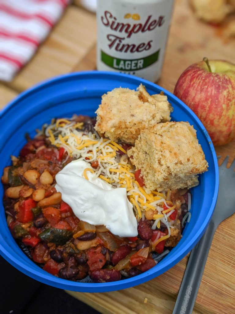 This bean chili with cornbread camping meal idea pairs well with cheap beer.