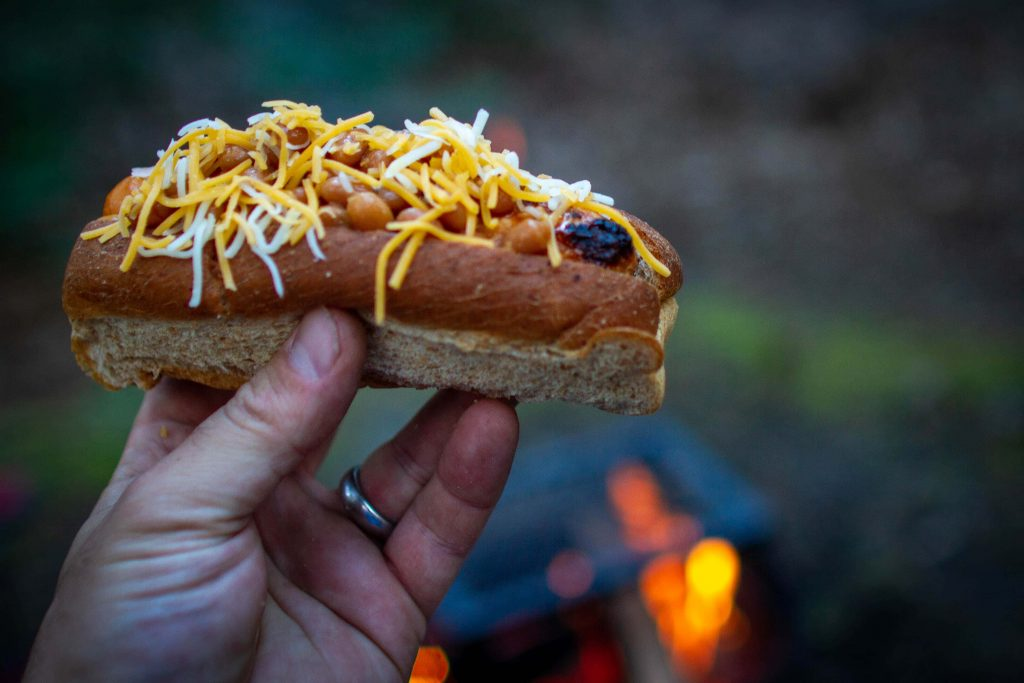 Hot dogs are a camp meal idea, but it is really easy to take your dogs to the next level.