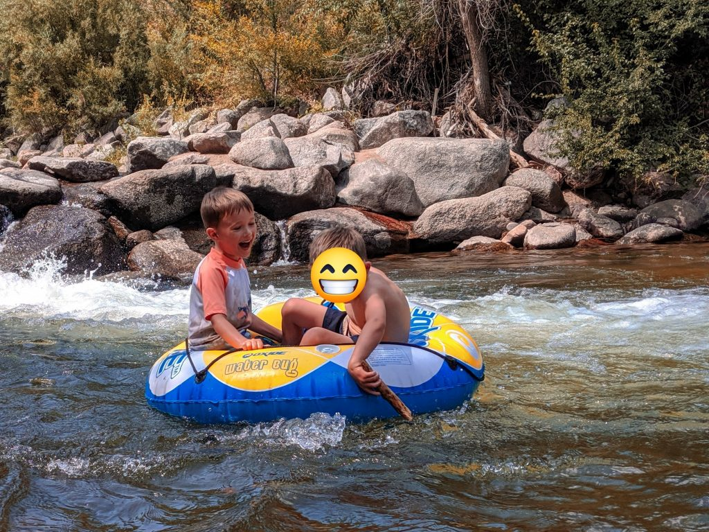 Lincoln and his new friend tubing down Eben G Fine Park on Day 1 of our perfect 3 day itinerary in Boulder with kids.